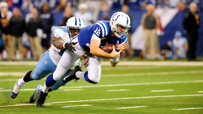 Colts quarterback Andrew Luck (12) is tackled by Titans defensive lineman Jurrell Casey (99) at the goal line during the 2016 season.