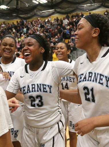 Bishop Kearney's Allure Simmons (23) celebrates with teammates after beating Mercy for the Class AA title.  Simmons was named MVP.