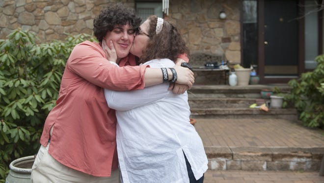 Lauren Meltzer, a 29-year-old with autism and bipolar disorder, is kissed by her mother,  Erna Page-Meltzer outside of Lauren's family's Voorhees home while visiting for the Passover holiday. Lauren's family protested the Return Home program, which required Lauren to leave her Connecticut program.