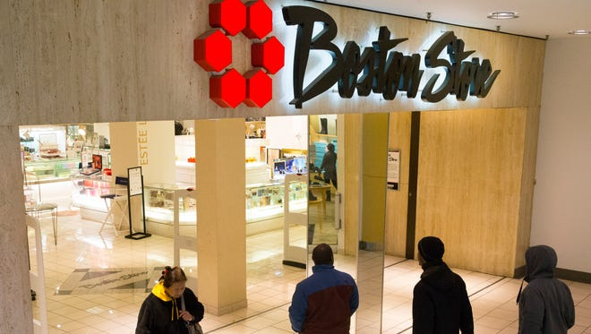 People enter and exit the Boston Store in downtown Milwaukee on Friday. Bloomberg News reported that Bon-Ton Stores Inc. has been in talks with private equity firm Sycamore Partners about buying some of the retailer's assets.