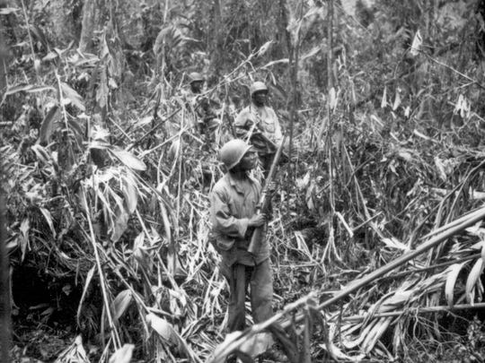 Members of the 93rd Infantry Division on patrol in Japanese territory off the Numa-Numa Trail in May 1944.