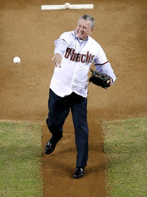 Former U.S. Attorney General John Ashcroft throws out the first pitch prior to a baseball game between the Los Angeles Dodgers and the Arizona Diamondbacks in a 2013 game in Phoenix. Ashcroft was once critical of Vin Scully when Ashcroft was governor of Missouri.