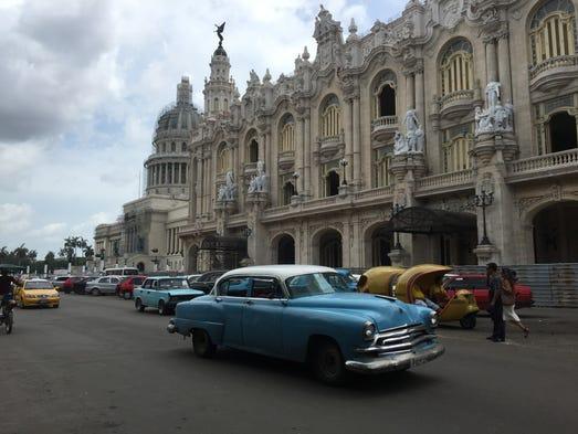 Classic cars alongside modern taxis, Old Havana.