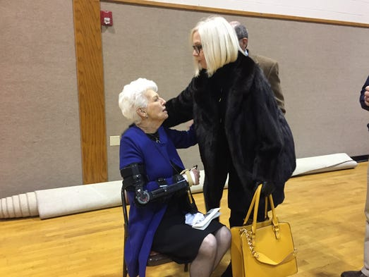 Joanne Sigler visits with a friend during the visitation