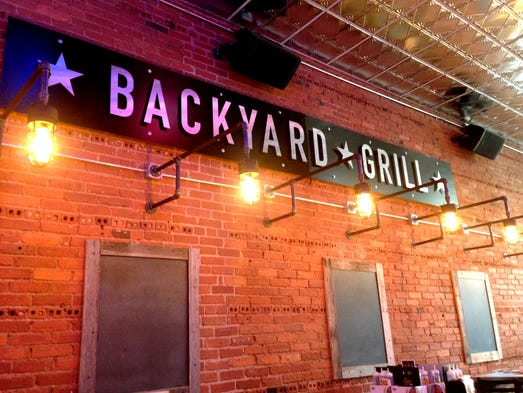 backyard grill opens downtown wednesday