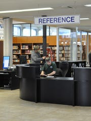 The Rapides Parish Library's Main Library in downtown Alexandria reopened Tuesday after being closed for more than two months for renovations, including the installation of ceramic tile and new carpet.