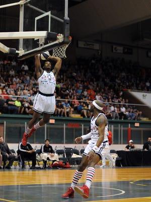 A Harlem Globetrotter goes up for a dunk Monday, April 18, at McMorran Arena.