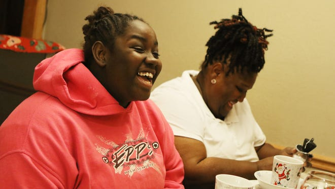 Lianca Wilson and Vernice Carter Wright laugh as they talk about how the foster system brought them together on Wednesday, December 14, 2016. Carter's adoption of Wilson, who will turn 18 on Christmas Day, was finalized on December 15. Carter said that when she met Wilson, she just fell in love with her bright smile and sense of optimism.