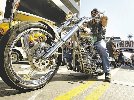 A motorcycle rider drives up Virginia Street in downtown Reno during Street Vibrations on Sunday, Sept. 28, 2008.