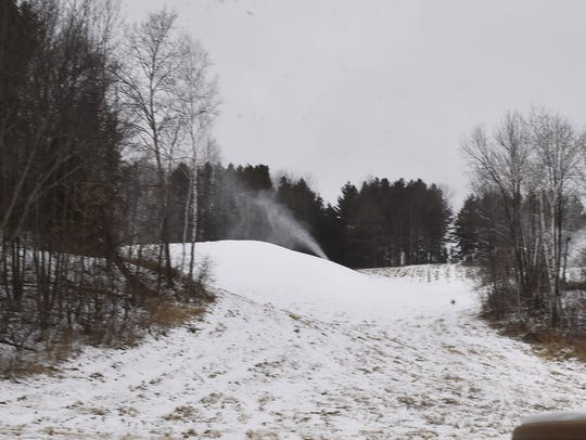Making snow on top of the snowboard/ski hill at Winter