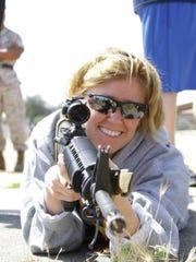 Christina Feneley beams as she prepares to fire an