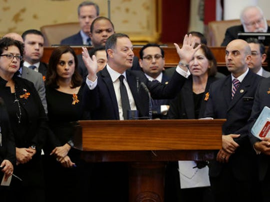 "Texas Rep. Rafael Anchia, D-Dallas, at podium, is surrounded by fellow lawmakers as he speaks against an anti-""sanctuary cities"" bill that has already cleared the Texas Senate and seeks to jail sheriffs and other officials who refuse to help enforce federal immigration law, Wednesday, April 26, 2017, in Austin, Texas.   Many sheriffs and police chiefs in heavily Democratic areas warn that it will make their jobs harder if immigrant communities, including crime victims and witnesses,  become afraid of police."