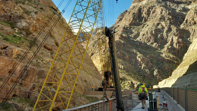 Crews work to install new bridge girders during a rehabilitation project in the Virgin River Gorge on March 4.