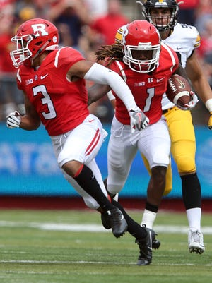 Rutgers takes on Iowa in their first Big Ten game of 2016 at High Point Solutions Stadium in Piscataway on Saturday September 24, 2016Rutgers # 1 (center) Janarion Grant pushes his team mate # 3 (left) Jawuan Harris out of the way as he breaks free for a huge yardage gain during the 1st half of play.