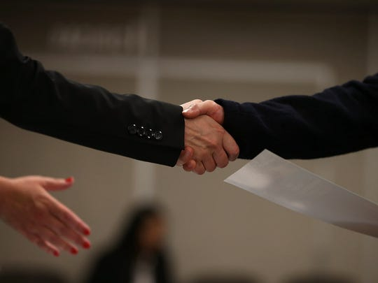 SAN FRANCISCO, CA - JUNE 04:  A job seeker shakes hands with a recruiter during a HireLive career fair on June 4, 2015 in San Francisco, California. According to a report by payroll processor ADP,  201,000 jobs were added by businesses in May.  (Photo by Justin Sullivan/Getty Images) ORG XMIT: 558192427 ORIG FILE ID: 475868206