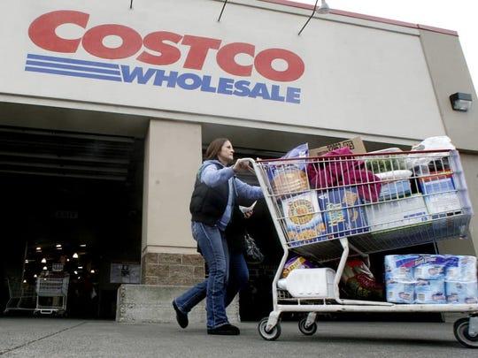 A shopper leaves a Costco store in Portland, Ore.