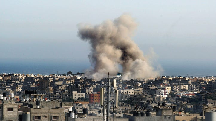 Smoke rises after an Israeli airstrike in Rafah in the southern Gaza Strip on July 12, 2014.
