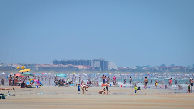 Beachgoers spend the Fourth of July holiday on Crescent Beach on Saturday.