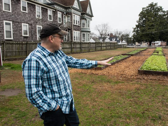 Martin Hutchison, pastor of the Community of Joy Church, talks about the Camden Community Garden, which is directly across the street from the future community center.