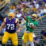 LSU quarterback Anthony Jennings (10) throws downfield, with protection from center Andy Dodd (72), during the Tigers' spring game on Saturday.