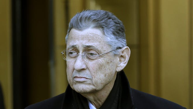 New York State Assembly Speaker Sheldon Silver leaves a federal courthouse in New York, Thursday, Jan. 22, 2015. Silver was arrested Thursday on charges he used his position as one of the state's most powerful politicians to collect millions of dollars in bribes and kickbacks disguised as legitimate income.  (AP Photo/Seth Wenig)