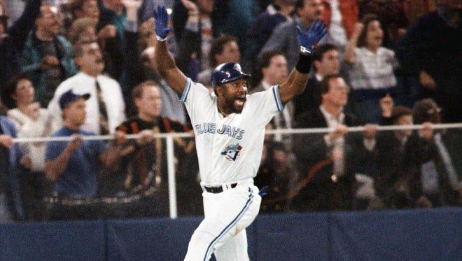 Joe Carter celebrates his game winning three-run home run in the ninth inning of Game 6 of the 1993 World Series in Toronto.