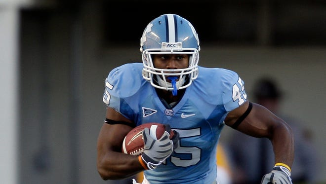 Former North Carolina Tar Heel Devon Ramsay is part of a lawsuit filed against the school for breach of contract over an academic scandal.