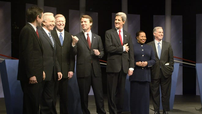 Democratic candidates for president line up before a debate in Des Moines on Jan. 4, 2004. From left: Dennis Kucinich, Joe Lieberman, Dick Gephardt, John Edwards, John Kerry, Carol Moseley Braun and Howard Dean.