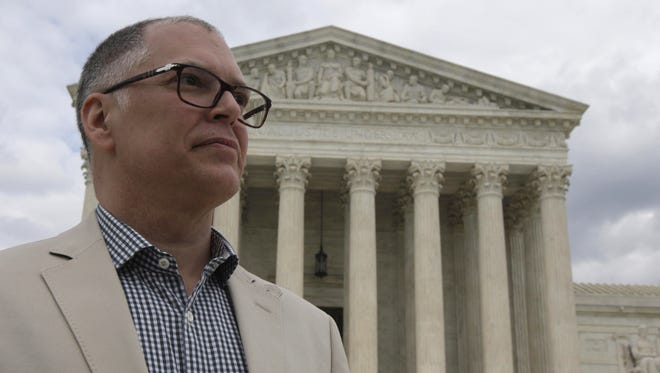 Jim Obergefell from Over-the-Rhine, the named plaintiff in the landmark gay marriage case Obergefell v. Hodges, stands in front of the United States Supreme Court Monday afternoon. His case is being heard Tuesday morning.