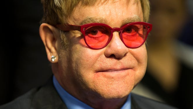Musician Sir Elton John arrives on Capitol Hill in Washington, Wednesday, May 6, 2015, to testify before the Senate State, Foreign Operations, and Related Programs subcommittee in support of U.S. funding for global HIV/AIDS treatment. (AP Photo/Evan Vucci)