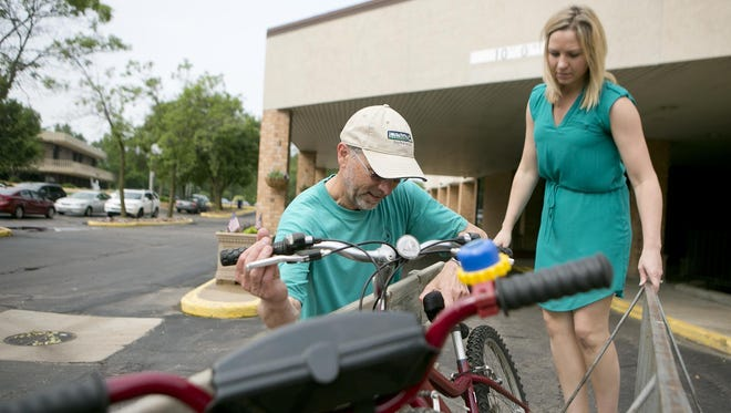 Clean Green Action's Joe Ancel, left, and Danielle Hiller, a public health nurse with Wood County and the co-chair for Healthy People Wood County, work on unloading bikes at Hotel Mead in Wisconsin Rapids on Tuesday, June 9. Hotel Mead is a site for the River Riders Bike Share program.