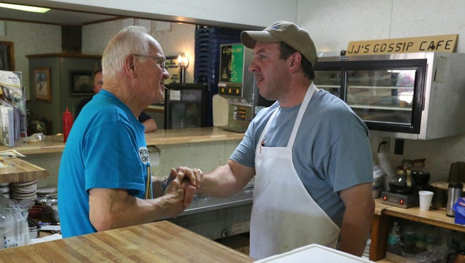 After finishing his meal regular customer Frank Wojcik of Stratford, left, bids farewell to owner John Schwabe at JJ's Cafe near Stratford. Friday is the last day the popular cafe is open. Schwabe will be taking the executive chef position with St. Joseph's Hospital in Marshfield.