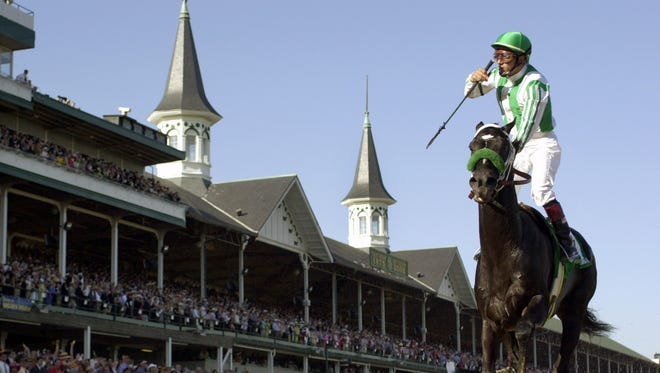 Jockey Victor Espinoza rides War Emblem to victory in the 128th Kentucky Derby at Churchill Downs on Saturday, May 4, 2002, in Louisville, Ky.