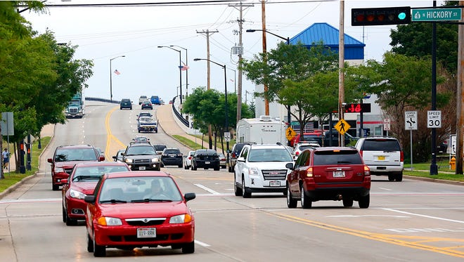 Traffic once again flows over Johnson Street at Hickory, after the intersection, and bridge east of the intersection, were closed for a week for street repairs. Saturday August 8, 2015.