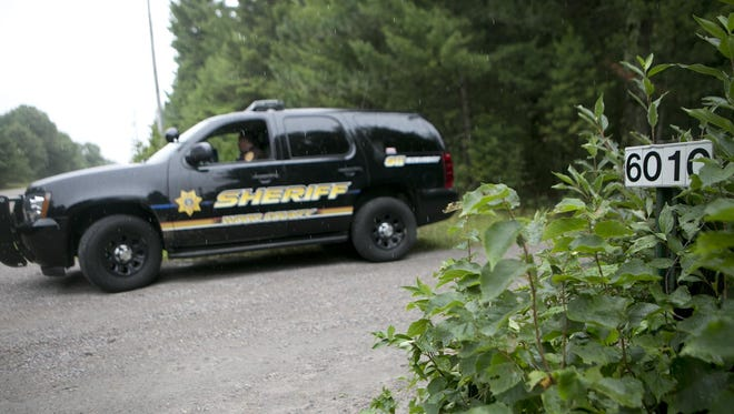 A Wood County Sheriff's Department vehicle sits in the driveway at 6010 Church Avenue in Saratoga.
