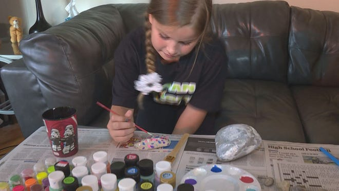 Morgan Franklin, 9, paints and sells rocks she collects to help pay for her own medical expenses.