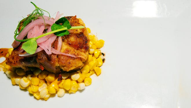 Crispy veal sweetbreads with sautéed corn, country ham and a molasses-black pepper reduction from The Bay House in North Naples.