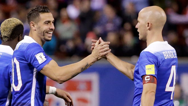 United States Geoff Cameron, left, is congratulated by teammate Michael Bradley after scoring during the second half of a 2018 World Cup qualifying soccer match against St. Vincent and the Grenadines.