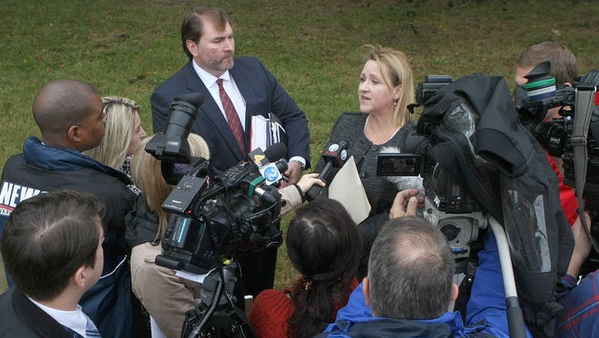 Special prosecutor Jennifer Nichols, Shelby County deputy district attorney, right, and Shelby County Assistant District Attorney Ray Lepone meet with the media outside of the Decatur County Courthouse after a hearing in the Holly Bobo case in Decaturville on Wednesday.