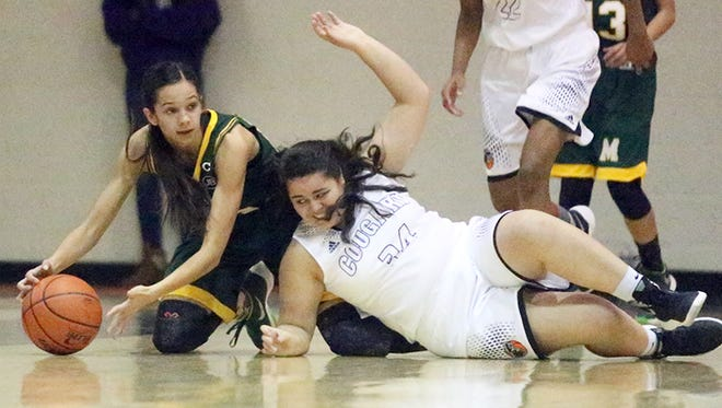 Franklin's Abby Cano, 34, right, takes a fall while going after the ball with Mayfield's Jayce Gorzeman, left, Tuesday night at Franklin.