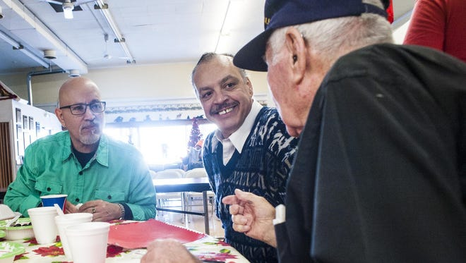 Ramon Kotwicki, left, and Martin Baca, center, talk to John Reynolds about his WWII experiences during a previous Danny Berg Memorial Dinner at the Great Falls Senior Center.