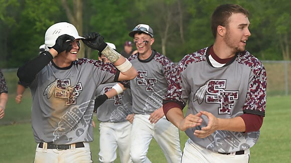 Dylan Gordon, left, and Trent Rider lead Southern Fulton's baseball team onto the field after winning the District 5-A baseball championship against Meyersdale in May 2015.