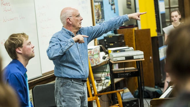 Dan Bukvich, a University of Idaho vocal and rhythm professor, directs choir students during a jazz workshop at Great Falls High School on Thursday.