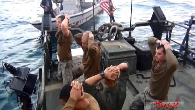 This image taken from video by the Iranian state-run IRIB News Agency shows detention of American Navy sailors by the Iranian Revolutionary Guards Tuesday in the Persian Gulf. The 10 sailors detained by Iran after their two small boats allegedly drifted into Iranian territorial waters around one of Iran's Persian Gulf islands a day earlier have been freed, the United States and Iran said Wednesday.