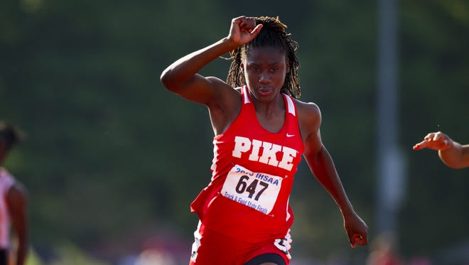 Pike's Lynna Irby, shown here crossing the finish line, setting a new state record in the 100-meter dash with a time of 11.50. at the 42nd annual Girl's Track and Field State Finals June 6, 2015.