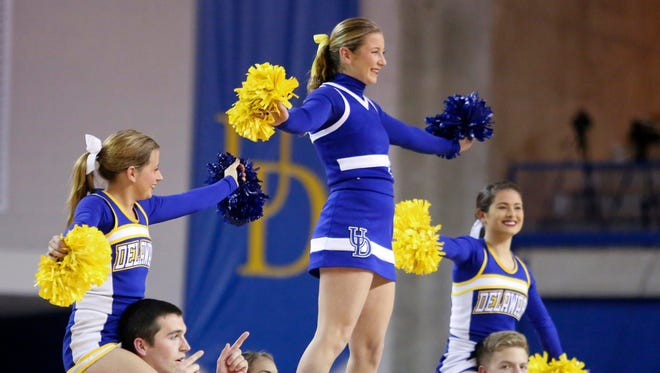 Delaware cheerleaders take the court in the first half at the Bob Carpenter Center Tuesday.