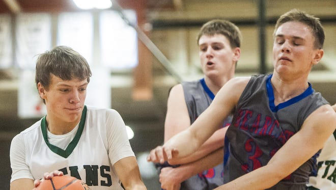 Tri-City's Chance McAllister dribbles around Denton-Geyser-Stanford's Kendall Carpenter during the District 8C basketball tournament in Swarthout Fieldhouse on Friday.