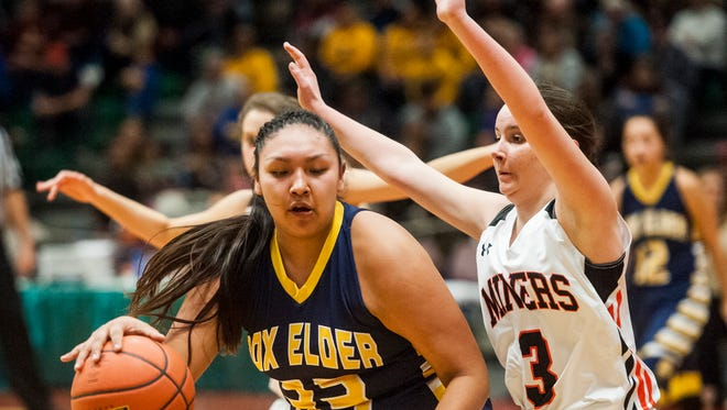 Box Elder's Tyra Gopher avoids a block from Centerville's Kenadee Chartier during the Northern C semifinal game in Four Seasons Arena Friday.
