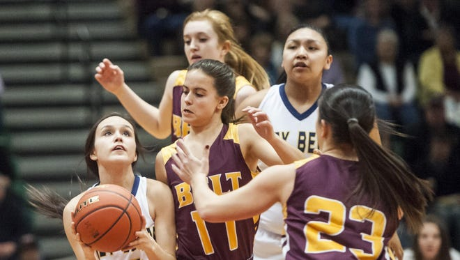 Box Elder's Alyssa LaMere shoots around Belt players Addy Martin, left, and Kerstyn Pimperton, right, during the Northern C girls championship game in Four Seasons Arena on Saturday.