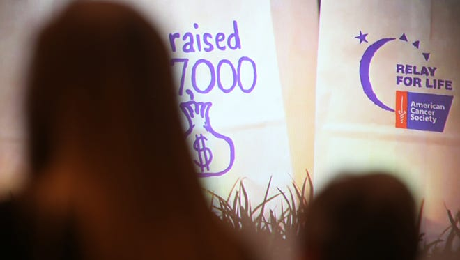 A Relay for Life video is shown during the March First Friday Forum in Clayton Hall at First United Methodist Church.